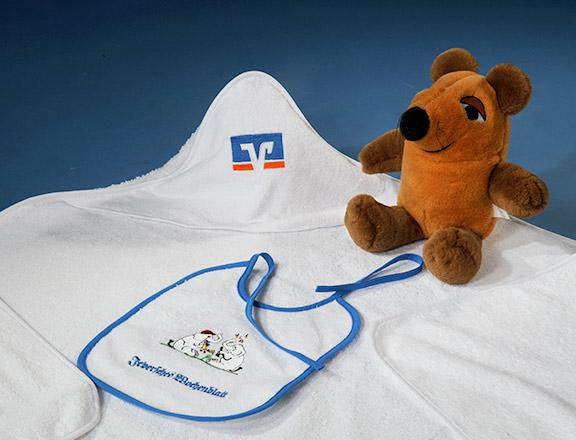 Kinderbademäntel und Lätzchen Topline GmbH